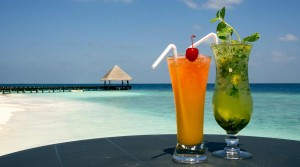 Colourful refreshing cocktail drinks on the beach in Maldives at a resort island