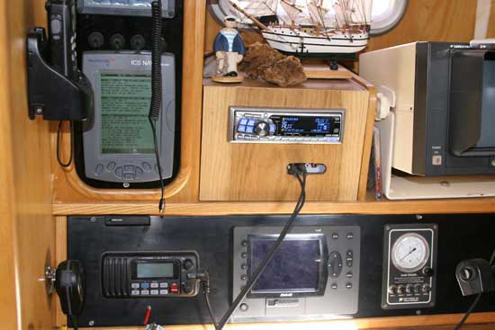 Navtex (topleft) with weather data displayed, along with the VHF (bottom left) and chart plotter (bottom centre), all now talking to each other. The water gauge (right) was also installed into the dash.
