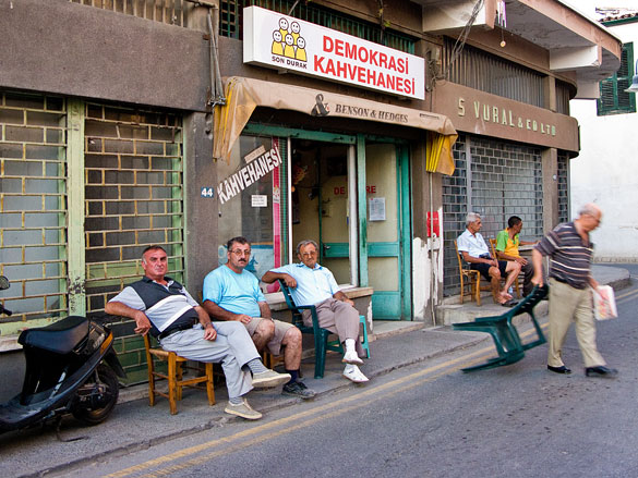 Gentlemen of Leisure, Lefkosia. Jamie: Funny how a camera can lie. In the above text Liz alludes to the happy, welcoming people of northern Lefkosia, yet this image appears to contradict that view. In fact as we turned the street corner to meet these men relaxing, we were again greeted with 'merhaba' (hello) and smiles. I asked these guys if I could take a picture of them and they happily obliged. And yet when that shutter opened for a split second...
