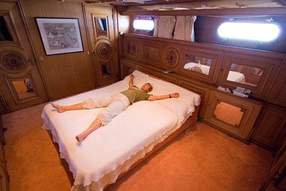 Liz relaxing in our cabin. Photograph not possible in a F6 with no stabilisers