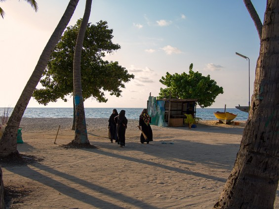 Women  sweeping the streets of Maafushi