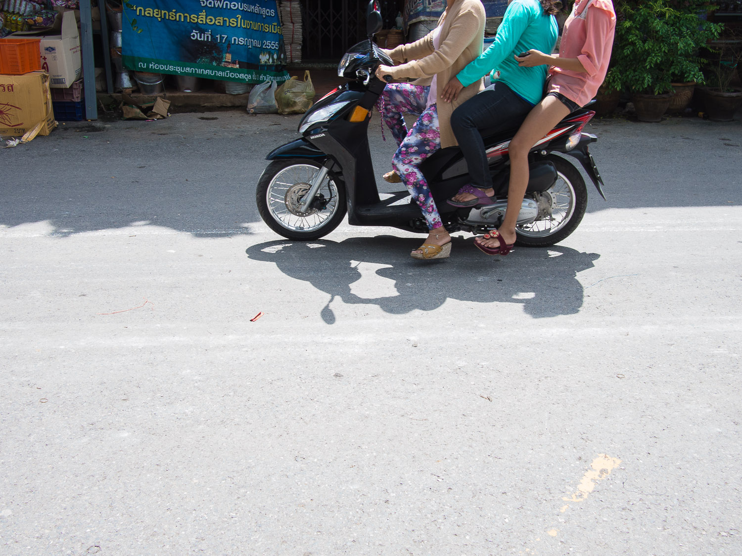 Ladies on a scooter in Satun, Thailand