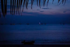 Esper lit up at anchor on Pantai Chenang