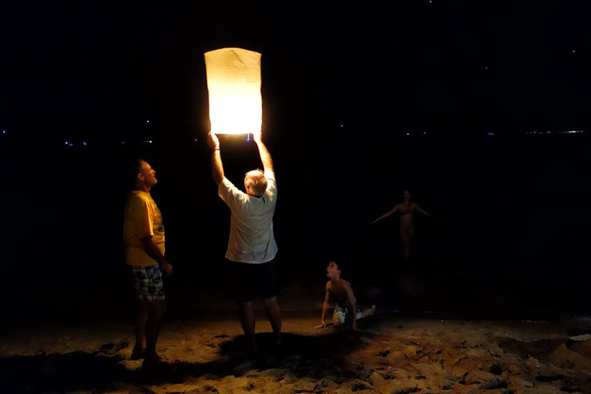 Keith of Poco Andante lights a lantern on New Year's Eve