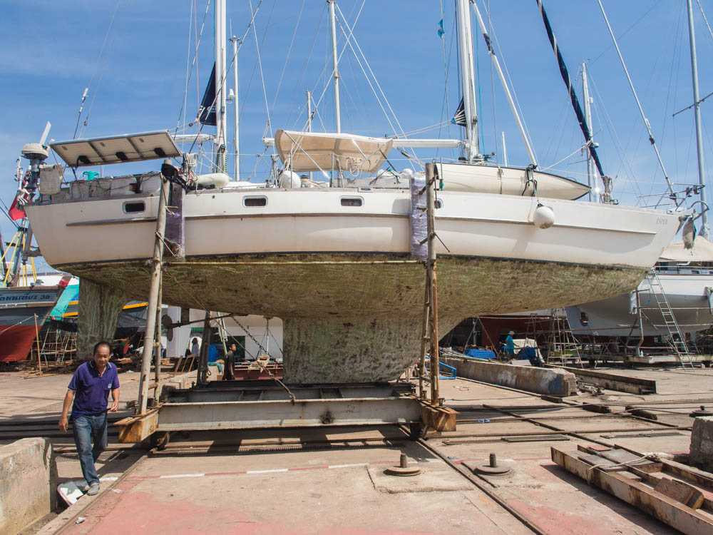 Pictured is the yard foreman in front of Esper, drying out in PSS Boatyard