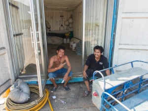 Roodee and Moo take a quick break outside our container. A rare moment of inactivity from these two lads
