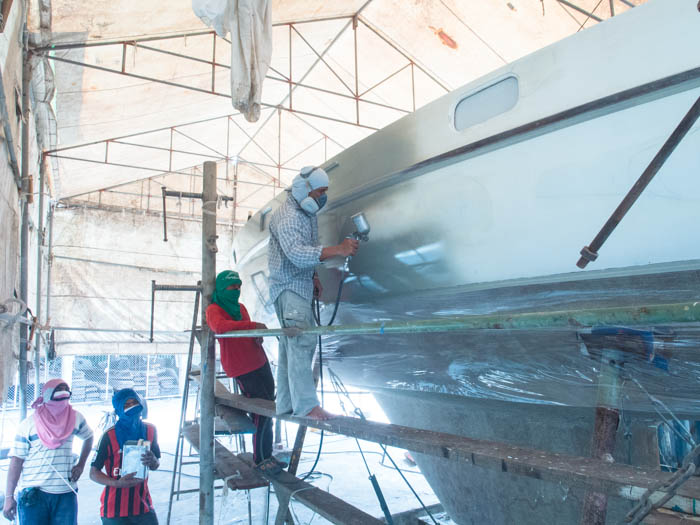 First layer of Jotamastic being applied to a GRP hull