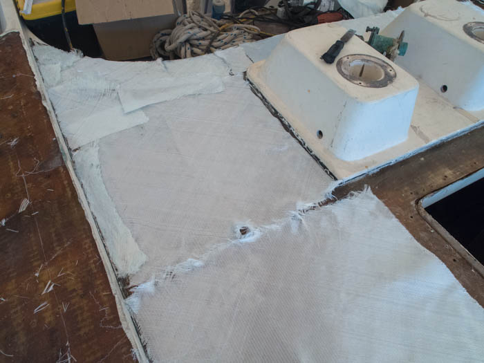 Biaxial fibreglass is cut to shape