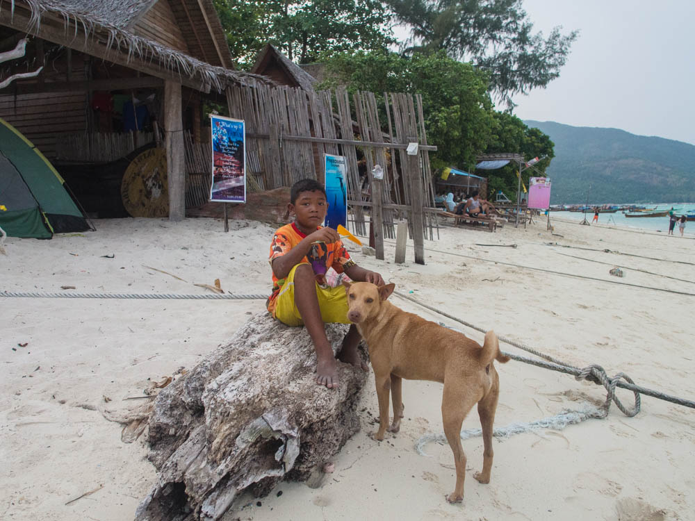 One lad and his dog on Ko Lipe
