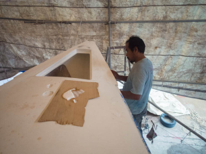 Fibreflass and epoxy filler on the edges of the boat