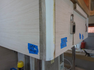 Section showing an unfinished corner and the masking tape for the electricians indicating the LED light locations