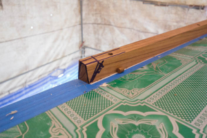 Teak toe-rail is offered up and measured for size