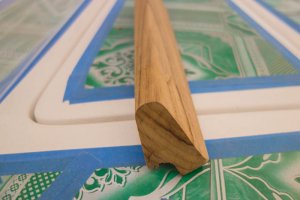 The final shape of the toe rail in profile